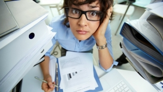 Busy worker at her desk