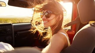 Woman in passenger seat of car