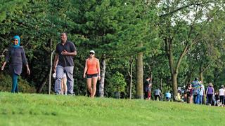 People walking in the park.