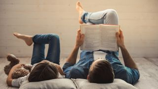 dad and son reading books