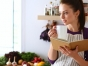 Woman holding a cookbook