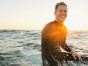Happy guy on a surfboard