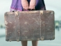 Woman with old baggage