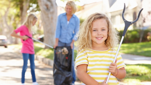 Mother and Daughters Picking up Trash