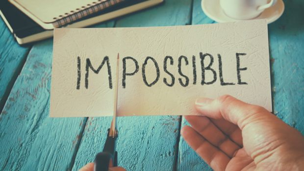 The word Impossible being cut in two