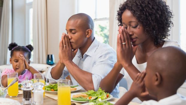 Family counting blessings before a meal
