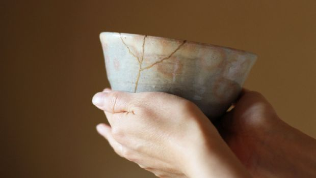 Wabi-sabi, hands holding a cracked piece of pottery